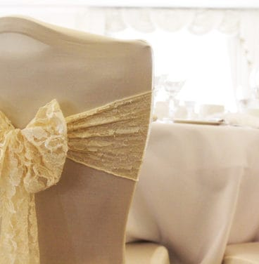 Wedding chairs with cover and gold ribbon