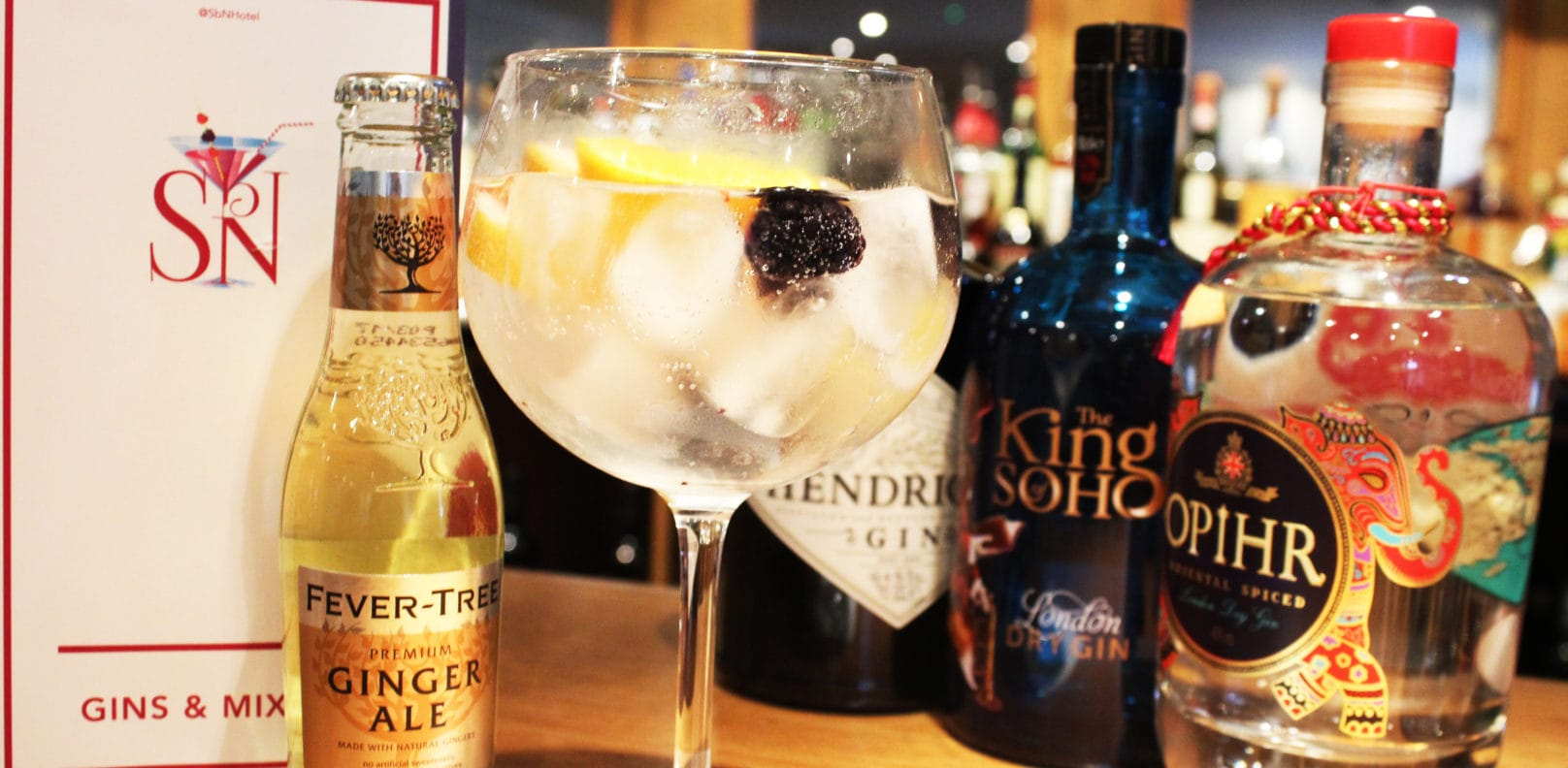 Gin glass with gins on bar