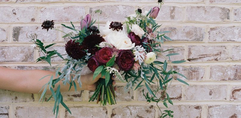 Wedding flowers by brick wall